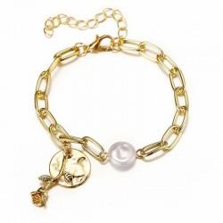 Pendientes con perlas blancas y piedra azabache