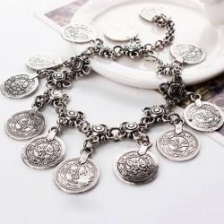 Pulseras con monedas de plata